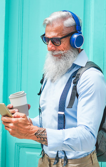 Hip old man with headphones, cell phone, coffee, tattoos